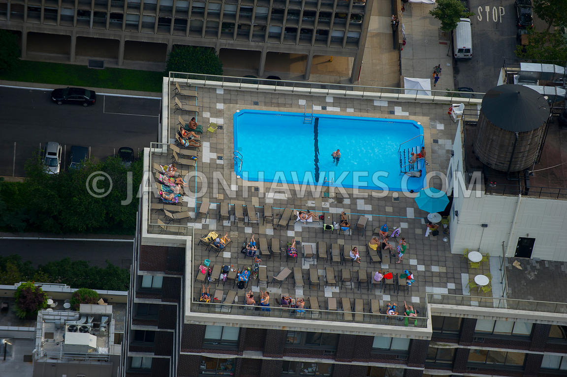 People in a swimming pool on top of a building in Midtown, Manhattan