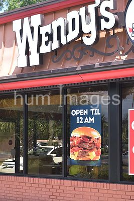 Wendy's restuarant advertisement signs in windows