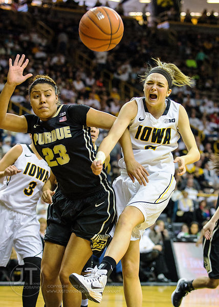 Iowa's Aly Disterhoft (2) is challenged on a shot by Purdue's Liza Clemons (23) during the second half of play at Carver-Hawk...