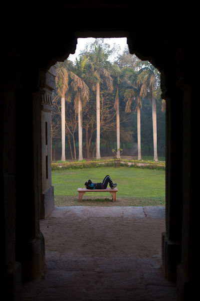 India - New Delhi - A woman exercises outside of Muhammad Shah Sayyid's mausoleum