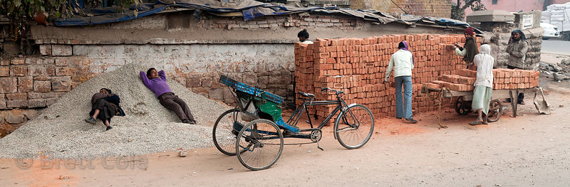 Workers building a brick wall in Delhi, India