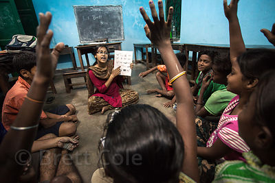 Children attend a school run by the ngo PATH Welfare Society, in Kumartoli, Kolkata, India