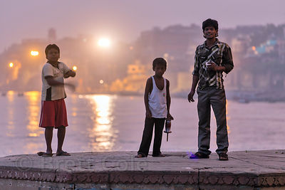 Children fly kites at night on the Ganges River, Prayag Ghat, Varanasi, India