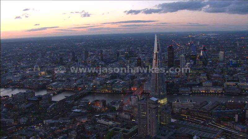 Aerial footage around The Shard at dusk, London, England