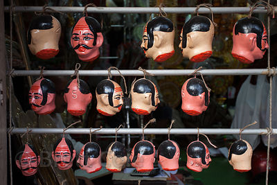Painted ceramic heads of an unidentified figure at a workshop in Kumartoli (Potter's Town), Kolkata, India.