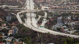Bird's Eye: Panning A Busy Highway To Meet L.A.'s Skyline During Sunset
