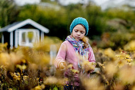 Little Danish girl in a blue hat in autumn 3