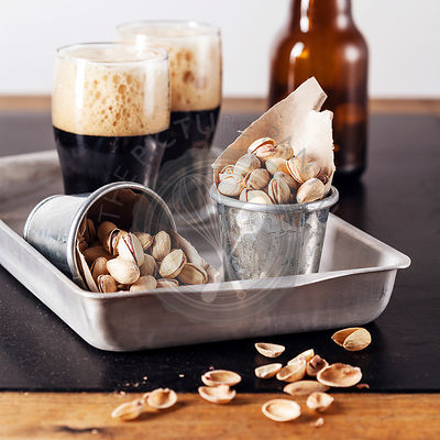Dark beer and salted pistachios