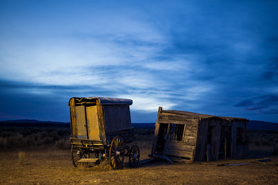 Wagon and Old House at Night