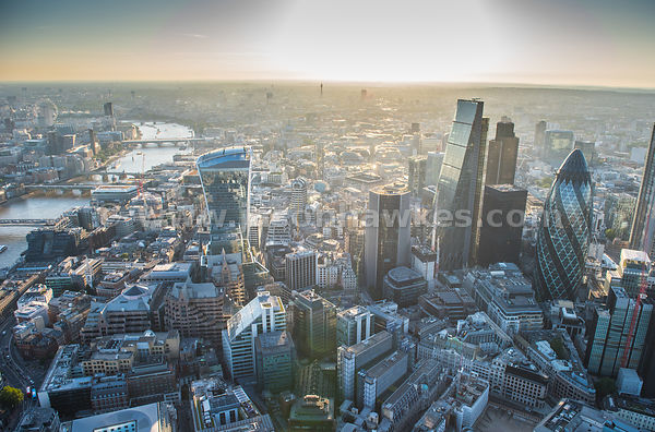The sun setting behind the skyscrapers of the City of London