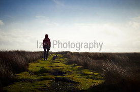 A hiker exploring the English Countryside, Muggleswick Common near Edmundbyers, England UK.