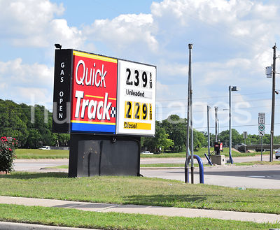 Quick Track Gas Station -Gas prices sign .