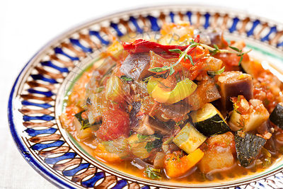 Traditional vegetable ratatouille on white background