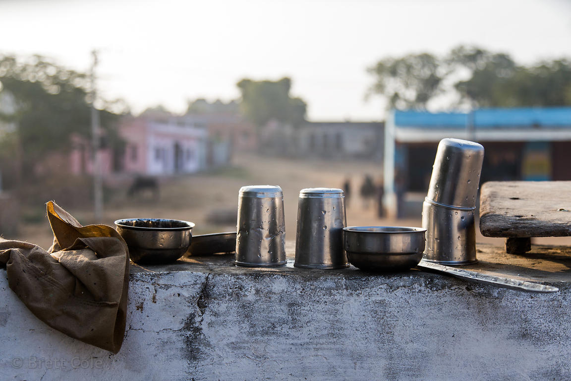 Metal drinking water cups on a farm, Surajkund village, Rajasthan, India