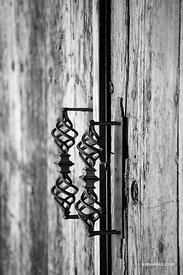 OLD DOOR IRON HANDLE NORTHERN NEW MEXICO BLACK AND WHITE VERTICAL