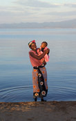 woman with child on the lakeshore, Likoma Island, Lake Malawi, Malawi
