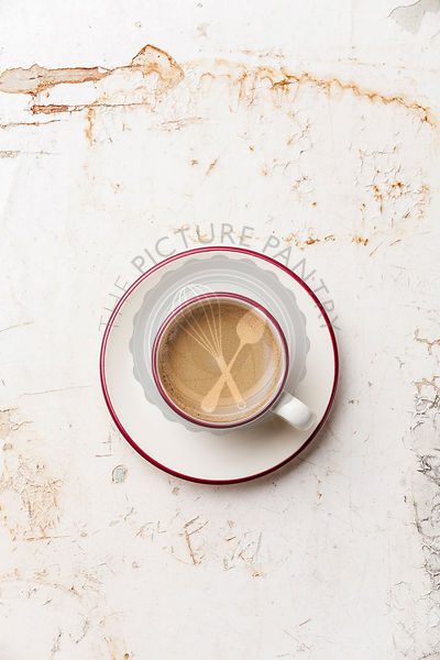 Coffee cup on beige background