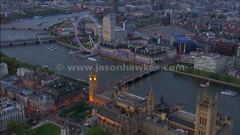 Aerial footage of Houses of Parliament at dusk, Westminster, London, England, UK
