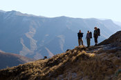 hikers walking around the Sentinel, Drakensberg Mountain, South Africa