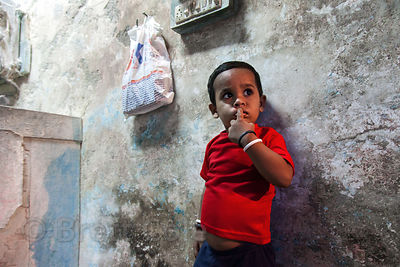 Boy in a flour mill at a market in Bandra East, Mumbia, India.