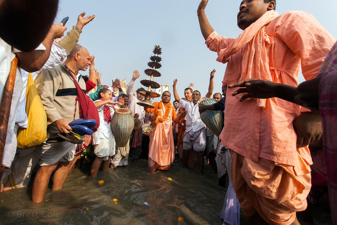 A group of Hare Krishnas pray on the beach at the Gangasagar Mela (festival), a pilgrimage to Sagar Island in India, where th...