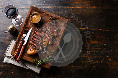 Grilled sliced Steak Striploin with Pepper sauce and Red wine on wooden background copy space
