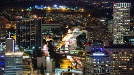 Bird's Eye: Lights Of An Expressway Cutting Through Downtown L.A. High-Rises