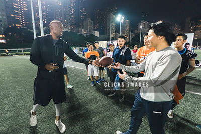 Football Clinic event with NFL Star Ashley Lelie host by Passing Play at Happy Valley Sports Ground on November 19, 2017 in H...