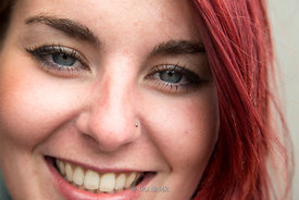 A close-up shot of a woman with red hair in London, UK.