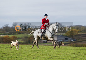Andrew Osborne MFh and two Cottesmore hounds