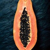 Papaya cross-section on dark slate