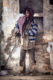 Homeless boy with mental illness in very dirty clothes, Pushkar, Rajasthan, India