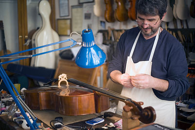 Italy - Bologna - Bruno Stefanini repairing a viola in his shop