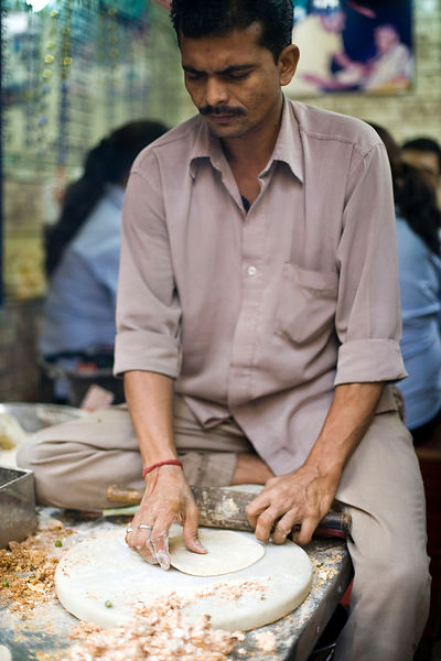 India - Delhi - A man making paratha at Parawthe Wala restaurant in Old Delhi
