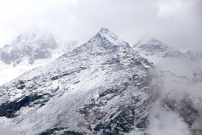 Fresh snow on 18,000 foot peaks in the Par Panjal Range, from the summit of Rohtang Pass, Manali, India