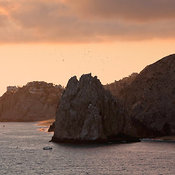 Stone arch at Land's End and town on cliff side, Cabo San Lucas, Los Cabos, Baja California Sur, Mexico