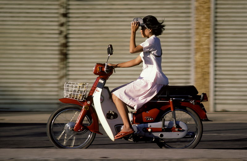 8187.08 Girl on moped-