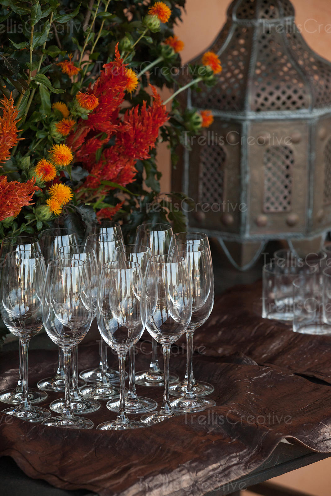 Flower arrangement with  wine glasses on table