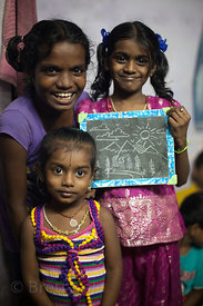 A classroom in the Kokri Agar slum near Antop Hill, Mumbaa, India. Children attend night classes here to practice what they'v...