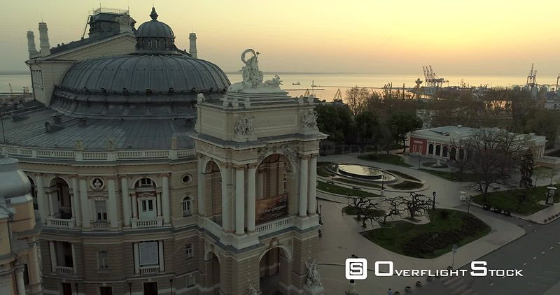 Aerial camera flies slowly away from the Odessa Opera Theatre at sunrise Ukraine