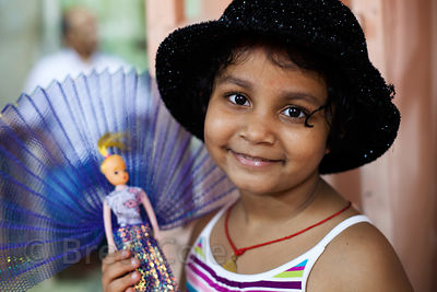 Portrait of a girl and her doll in Lalbaug, Mumbai, India.