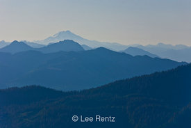 Glacier Peak and the blue ridges of the Cascade Mountains in early morning light, viewed from the Railroad Grade Trail, Mt. B...