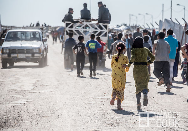 Children Running After A Truck At Hamam al Alil IDP Camp Near Mosul