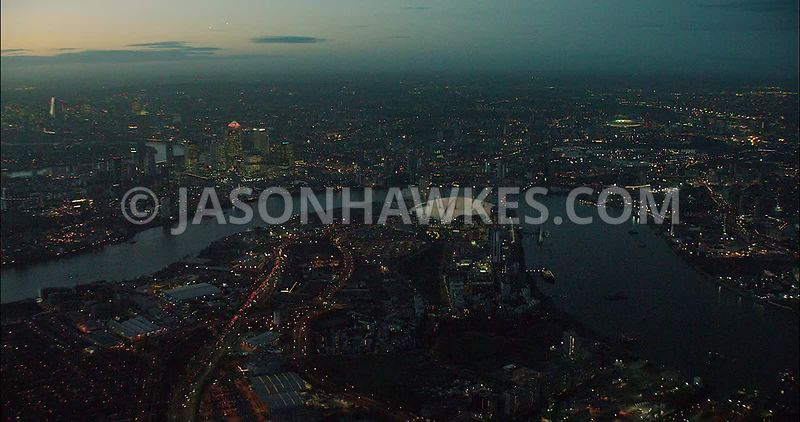 London night aerial footage,  O2 Arena and Canary Wharf at night.