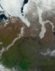 RUSSIA -- 07 Jun 2001 -- This true-color satellite image shows ice retreating from the mouth of the Ob River in northern Russia