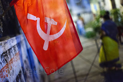 Flag with the Commmunist party logo, Kalighat, Kolkata, India.
