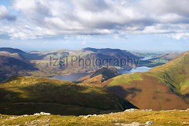 Views of Lake Buttermere, Crummock Water, High Stile and Red Pike from the summit of Robinson in the Lake District, England, UK.