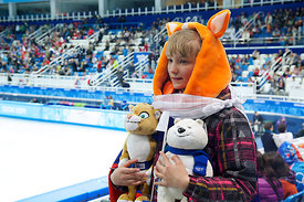 SPECTATOR WITH OLYMPIC MASCOTS