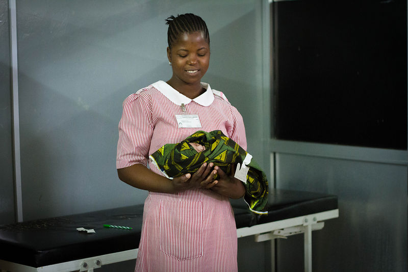 Trainee midwife with newborn, Sekou Toure Hospital, Mwanza, northern Tanzania (for the Touch Foundation).