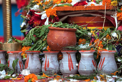 Clay pots full of flowers at a Durga Puja pandal near Kumartoli, Kolkata, India.